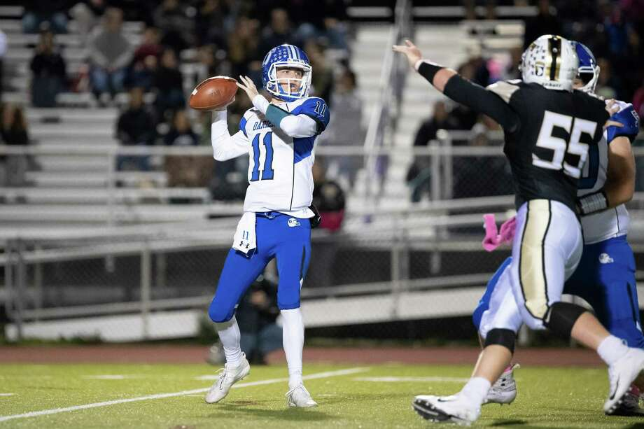 Darien QB Peter Graham gets set to throw a pass during the Blue Wave's win over Trumbull on Friday, Oct. 4. Photo: David G. Whitham / For Hearst Connecticut Media / Stamford Advocate Freelance
