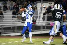 Darien QB Peter Graham gets set to throw a pass during the Blue Wave's win over Trumbull on Friday, Oct. 4.