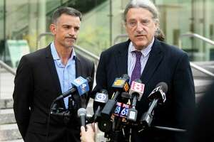 Fotis Dulos, left, listens as his attorney Norm Pattis address the media after appearing at the Connecticut Superior Court in Stamford, Conn., Monday, Sept. 23, 2019. Dulos, who is charged with evidence tampering and hindering prosecution in the May disappearance of Jennifer Dulos from New Canaan, is currently free on $1 million bond and being monitored by a GPS system. (Tyler Sizemore/Hearst Connecticut Media via AP)