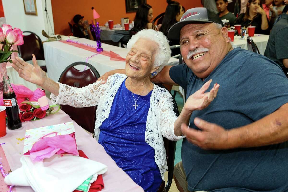 """Ofelia Gonzales smiles for a photo with Raul """"Butch"""" Salgudo while celebrating her 109th birthday with friends and family at Arizona Cafe, 1111 S. General McMullen Dr., on Thursday, Oct. 10, 2019. Gonzales is one of approximately 70,000 centenarians living in the United States."""