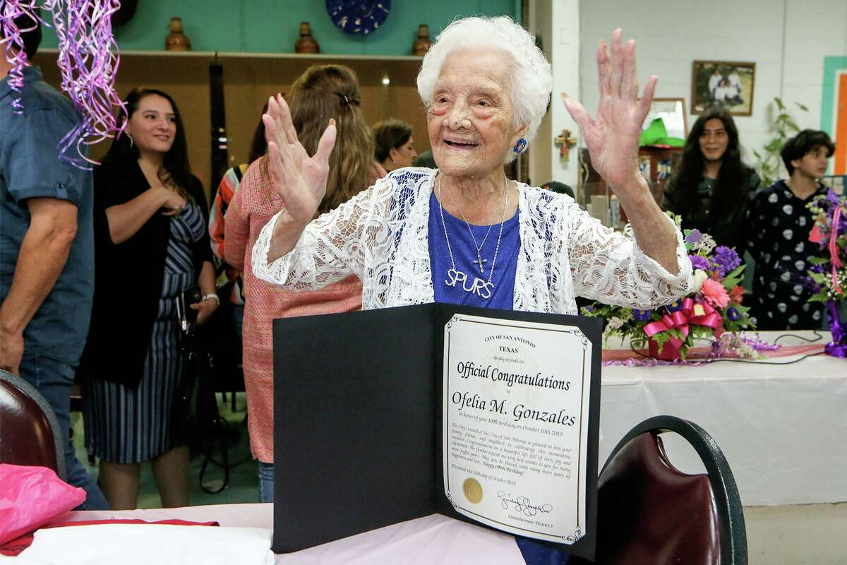 Ofelia Gonzales reacts after receiving official congratulations from Councilwoman Shirley Gonzales' office and the City Council while celebrating her 109th birthday with friends and family at Arizona Cafe, 1111 S. General McMullen Dr., on Thursday, Oct. 10, 2019. Gonzales is one of approximately 70,000 centenarians living in the United States.