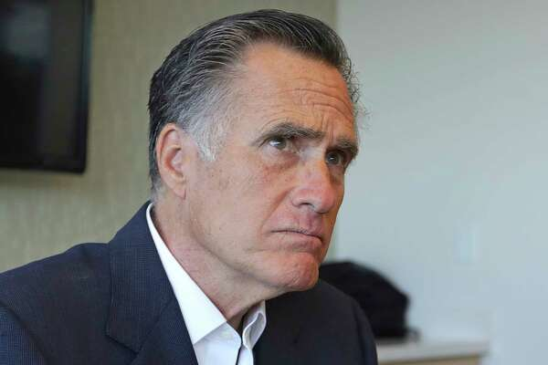 Sen. Mitt Romney, R-Utah, listens to reporters following a roundtable discussion at Intermountain Primary Children's Hospital with officials and health experts to receive an update on anti-vaping efforts Thursday, Oct. 10, 2019, in Salt Lake City. In his first public appearance since President Donald Trump unleashed a storm of insults on Twitter, Romney stuck by his criticism of Trump's actions but said he expects him to re-elected. (AP Photo/Rick Bowmer)