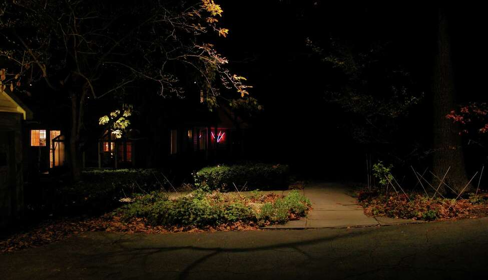 In Brunswick, Janet Lennox Moyer used downlighting, rather than path lights, to illuminate the route from her driveway to her front door.
