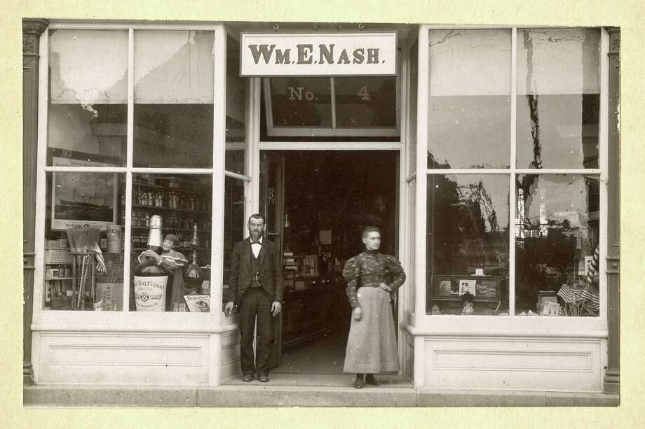 William Edgar Nash's apothecary and the storefront shows him and his daughter Carrie Nash St. John circa 1900. Photo: Contributed