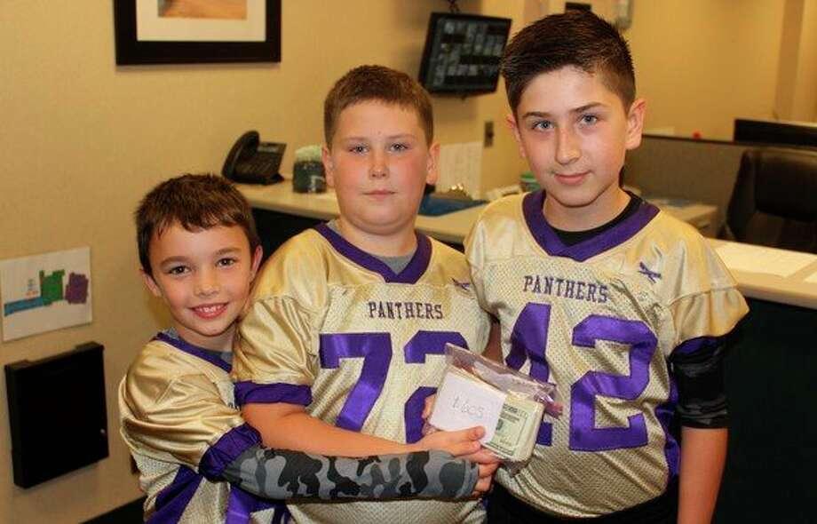 Frankfort Elementary students Brady Garrett, Alex Lovegrove and Blake Lovegrove donate $605 to the Frankfort Student Needs Fund. (Photo/Robert Myers)