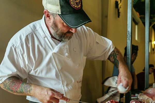 The fourth annual Butcher's Ball, showcasing ethical and sustainable ranching and farming in Texas, will be held Oct. 20, 2019 in Brenham. Shown: Chef Richard Knight carving.