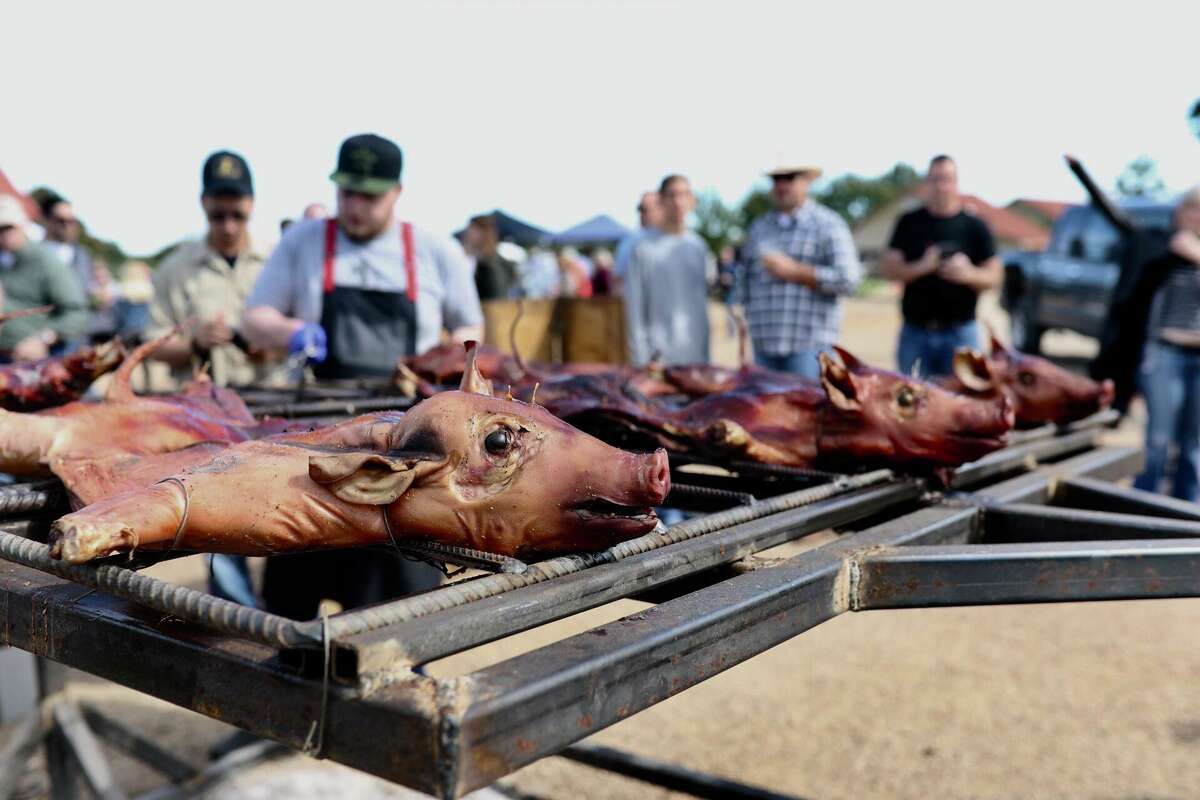 The fourth annual Butcher's Ball, showcasing ethical and sustainable ranching and farming in Texas, will be held Oct. 20, 2019 in Brenham. Shown: Pigs on the grill at the 2018 festival.