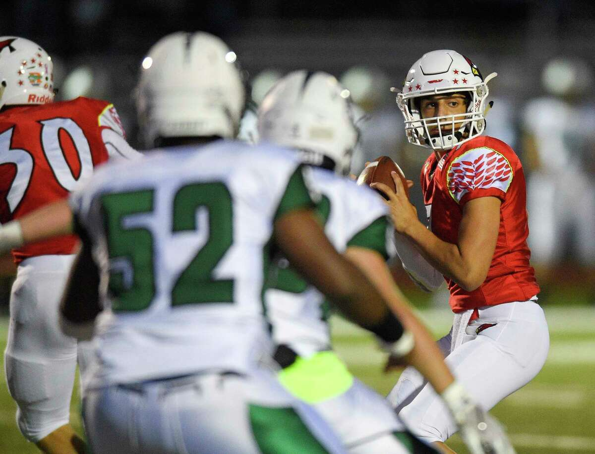 Greenwich quarterback James Rinello (7) stays in the pocket under pressure from Norwalk during a game on Sept. 27 in Greenwich.