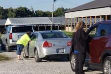 Nearly 100 cars drove through the Macoupin County Public Health Department's annual flu clinic on Oct. 8 at the Macoupin County Fairgrounds.