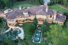 "Situated over nearly 20 acres and boasting more than 14,000 square feet, this $12 million palatial estate in Magnolia is outfitted with stunning amenities such as a climate controlled wine room, custom media room with private balcony, a ""man cave,"" three pools, in-ground trampoline, private sports court, par-3 golf hole, private pond, large gazebo, outdoor kitchen and more."