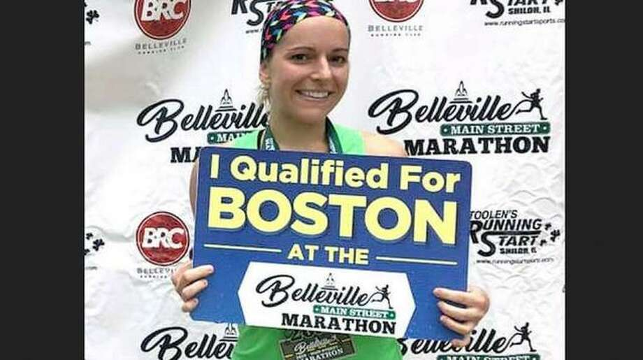 Mary Kronable of Godfrey poses at the finish line after winning the recent Belleville Main Street Marathon. As a result of her win, she qualified for the next Boston Marathon, set for April 20, 2020.