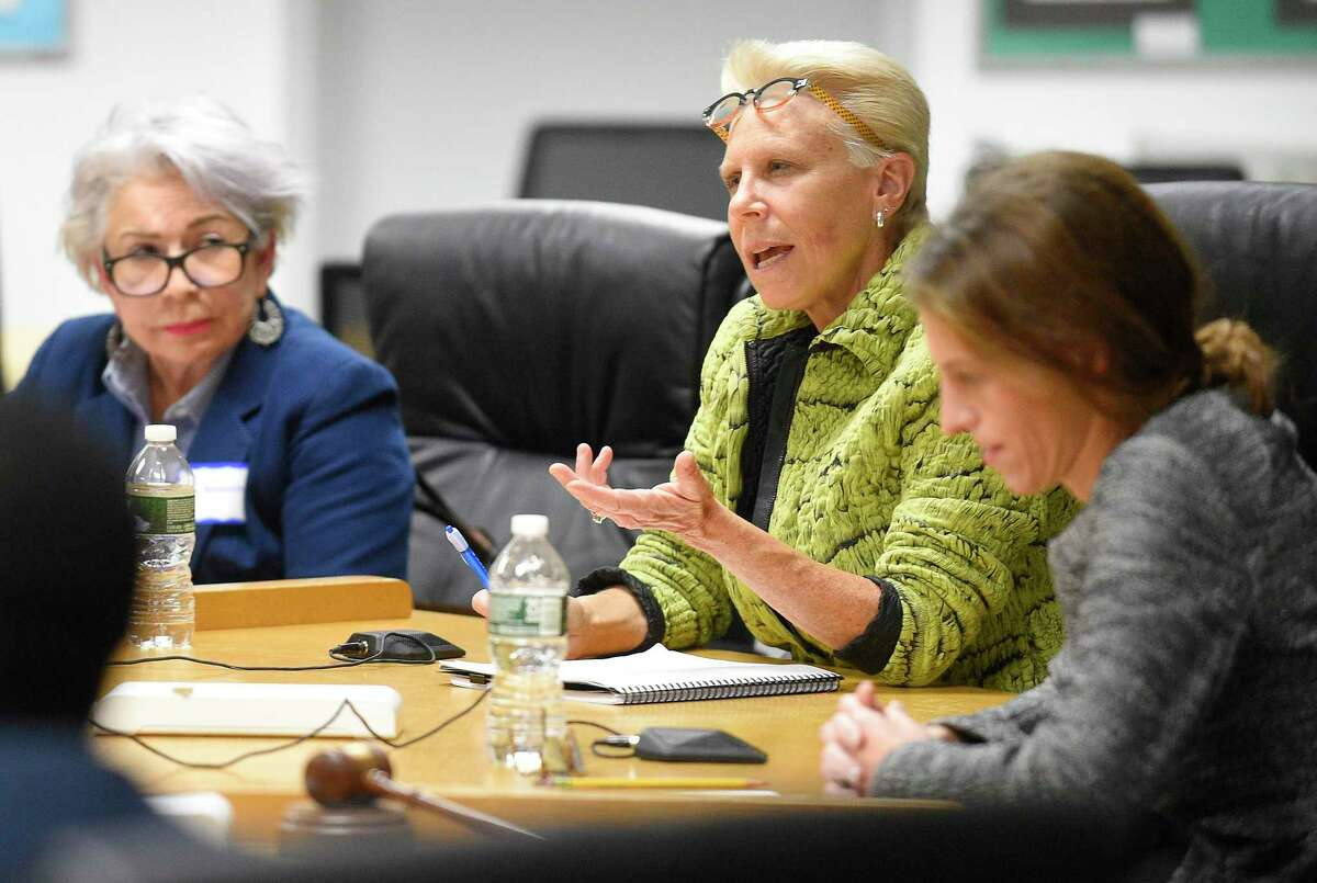 Candidate Rebecca Hamman, center, answers questions during the 5th annual Angela Lorenti Memorial Board of Education Forum hosted by the Parent-Teacher Council of Stamford at the Government Center in Stamford, Conn. on Oct. 10, 2019. Candidates answered a variety of questions before a couple dozen parents, educators and elected officials.