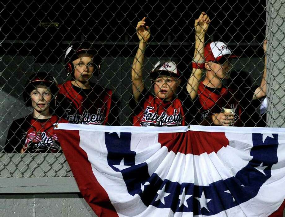 Members of the Fairfield American Little League team watch from the dugout during their game against Rhode Island in Bristol on August 6, 2010. Photo: Lindsay Niegelberg / Connecticut Post