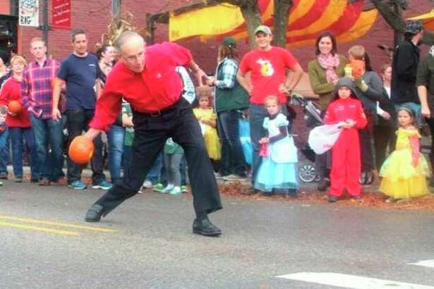 """One of Big Rapids Downtown Business Association director Josh Pyles' favorite activities to watch during the Big Rapids Fall Festival is the Celebrity Pumpkin Race. Pyles said it's fun to watch because """"you never know what will happen with the pumpkin hits the pavement."""" (Pioneer file photo)"""