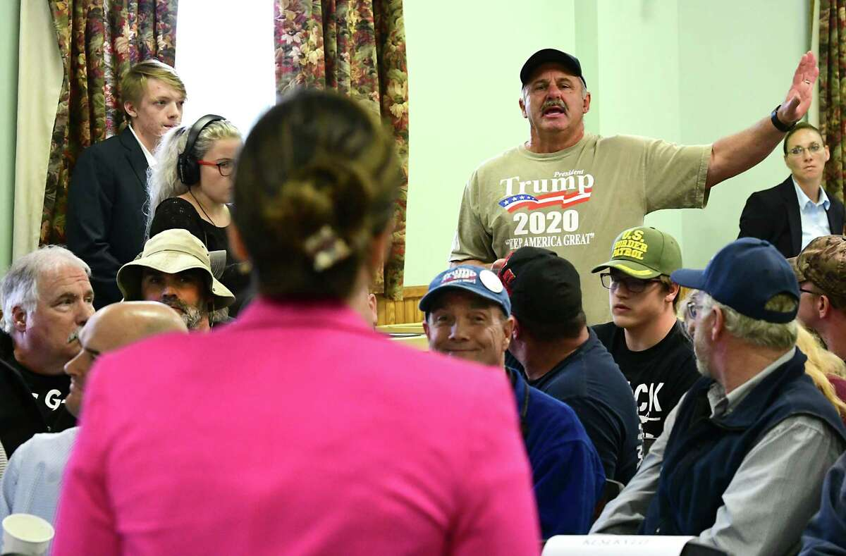 Rich Santerre of Queensbury asks U.S. Rep. Elise Stefanik a question during a town hall event at the Kingsbury Fire House on Friday, Oct. 11, 2019 in Kingsbury, N.Y. (Lori Van Buren/Times Union)