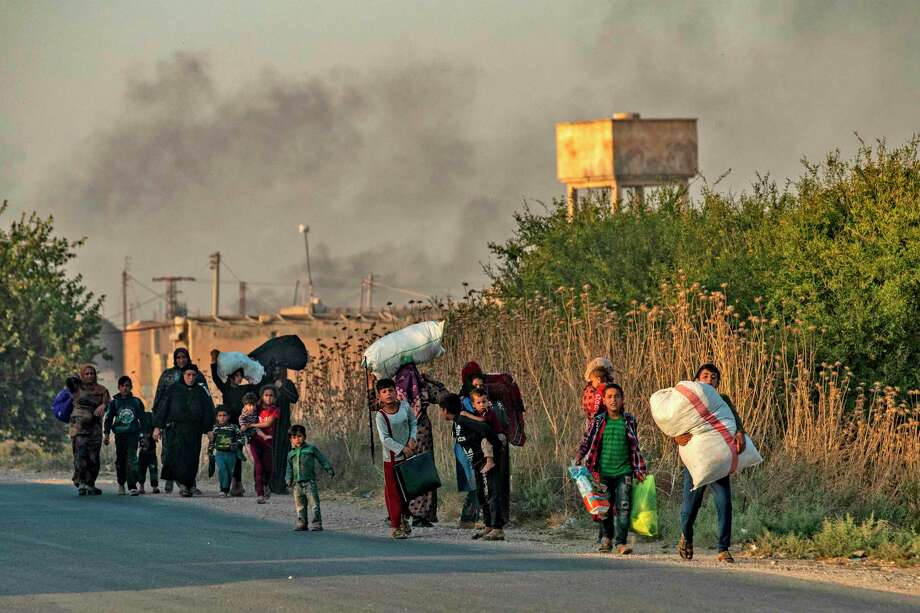 Civilians flee with their belongings amid Turkish bombardment of northeastern Syria. Readers describe Trump's actions to withdraw from the region as a betrayal of the Kurds. Photo: Delil Souleiman /AFP Via Getty Images / AFP or licensors