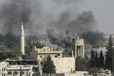 Smoke rises over the Syrian town of Ras al-Ain, following Turkish military action agains Syrian Kurds. In abandoning the Kurds, President Donald Trump has betrayed an ally and invited more terrorism.