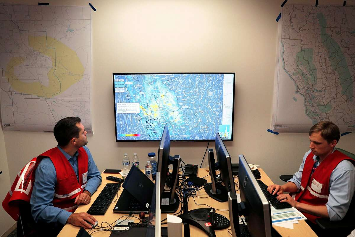 Principal Meteorologist Scott Strenfel, left, and A. J. Eiserloh, monitor wind speed projections at PG&E's Emergency Operations Center in San Francisco, Calif., on Wednesday, October 9, 2019. The utility�s personnel there manage the public safety power shutoffs, which began last night and will continue throughout the day today as the Diablo winds begin to rise.