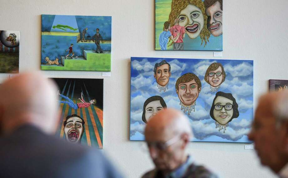 Various art hangs on the walls of the Art Museum of Southeast Texas as people eat lunch at the Sue Mann Weisenfelder Cafe Thursday afternoon. Beaumont's downtown recently was designated a cultural district by the Texas Commission on the Arts Photo taken on Thursday, 09/12/19. Ryan Welch/The Enterprise Photo: Ryan Welch, Beaumont Enterprise / The Enterprise / © 2019 Beaumont Enterprise