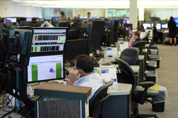 Investment professionals work on the trading floor at Point72 Asset Management's headquarters at 72 Cummings Point Road in Stamford, Conn., on July 18, 2016. A gender-discrimination lawsuit that was filed in 2018 against the hedge fund remains in arbitration.