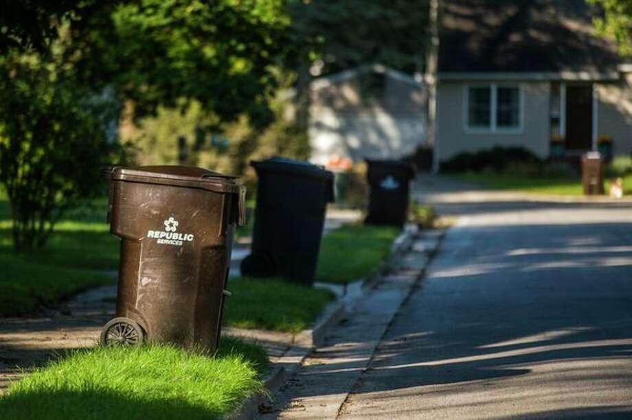 Recycling bins line the streets Wednesday in Midland. (Katy Kildee/kkildee@mdn.net)