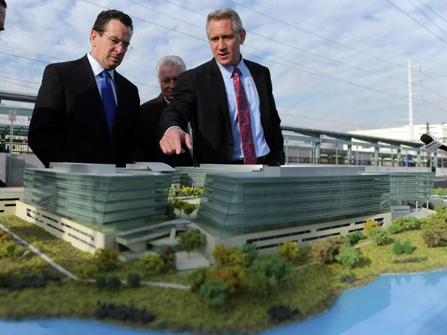 Kurt Wittek, managing partner of Blackrock Realty the private developer of the site, talks to Governor Dannel P. Malloy about future development plans as they look at a model of the Fairfield Metro Station Friday, Dec. 2, 2011 following a ribbon cutting ceremony to mark its official opening. Photo: Autumn Driscoll / Autumn Driscoll