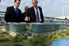 Kurt Wittek, managing partner of Blackrock Realty the private developer of the site, talks to Governor Dannel P. Malloy about future development plans as they look at a model of the Fairfield Metro Station Friday, Dec. 2, 2011 following a ribbon cutting ceremony to mark its official opening.