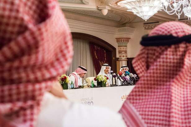 Abdulaziz bin Salman, Saudi Arabia's energy minister (center) speaks during a news conference with Amin Nasser, chief executive officer of Aramco (right) and Yasir Al-Rumayyan, chairman of Aramco, in Jeddah, Saudi Arabia, on Sept. 17, 2019. MUST CREDIT: Bloomberg photo by Iman al Dabbagh.
