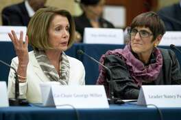 Rep. Rosa DeLauro, D-Conn., right, listens as House Minority Leader Nancy Pelosi of Calif., speaks during a House Democratic Steering and Policy Committee hearing.