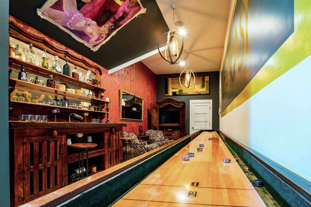 A speakeasy-style game room with 22-foot shuffleboard is one of the features of the estate home in The Estates at Cane Island that was named winner of a Greater Houston Builders Association PRISM award in the category of Best Custom Home Design for homes priced between $1 million and $1.5 million.