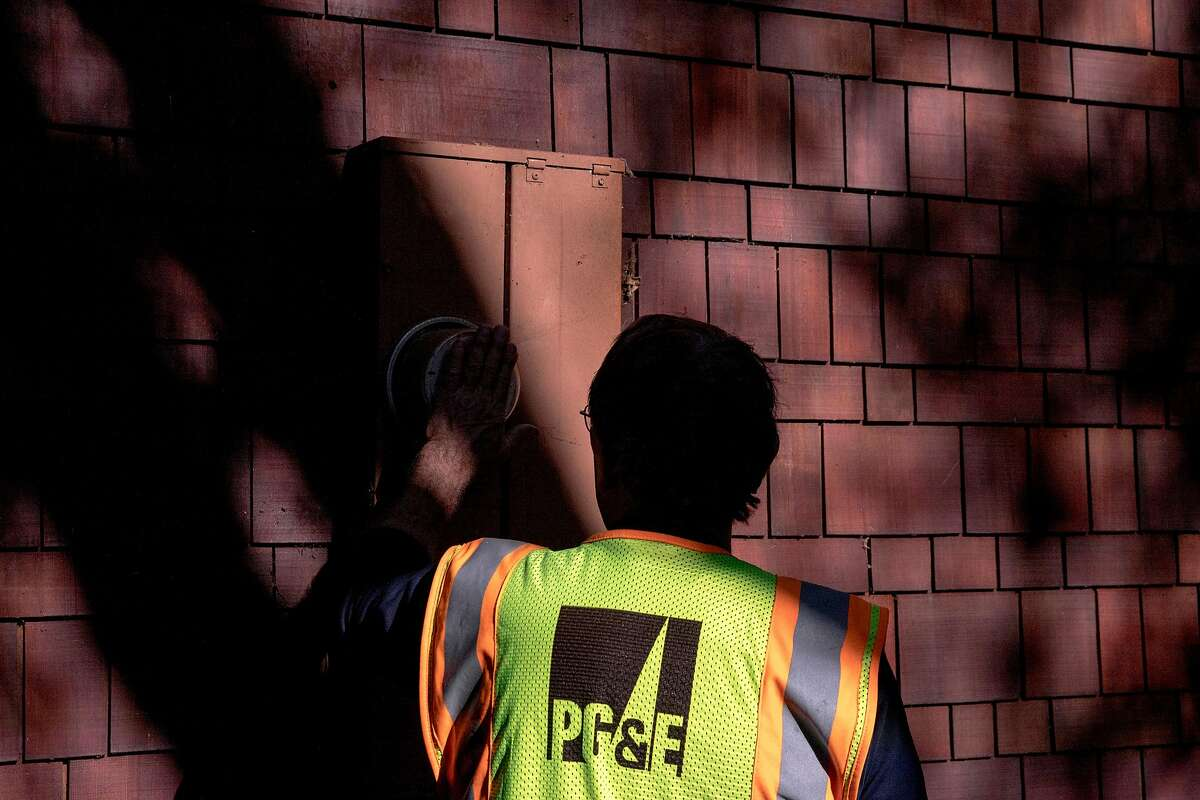 PG&E crew member Rick Bertel observes a power meter while inspecting power lines for damage along Camellia Lane in Lafayette, Calif. Friday, Oct. 11, 2019.