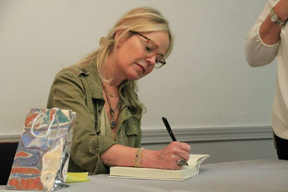 "Author Dani Shapiro signs copies of her book, ""Inheritance: A Memoir of Genealogy, Paternity and Love,"" at an event at Brookfield Library. Residents across Brookfield read the book as part of the summer ""One Town, One Read"" program. Photo: Contributed Photo / Contributed / The News-Times Contributed"