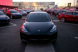 Smart Summon allows Tesla cars to drive themselves through parking lots. (Tesla/TNS)