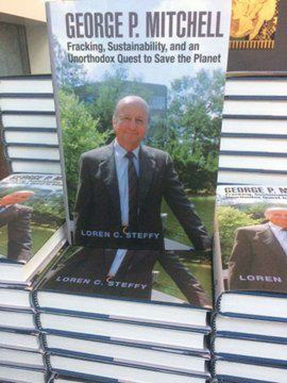 """Loren C. Steffy signs copies of his new book on Oct. 10, 2019, which is about oil tycoon and founder of The Woodlands George Mitchell. The book - titled """"George P. Mitchell: fracking, sustainability, and an unorthodox quest to save the planet"""" - was recently published in hardback form and was on sale during the event"""