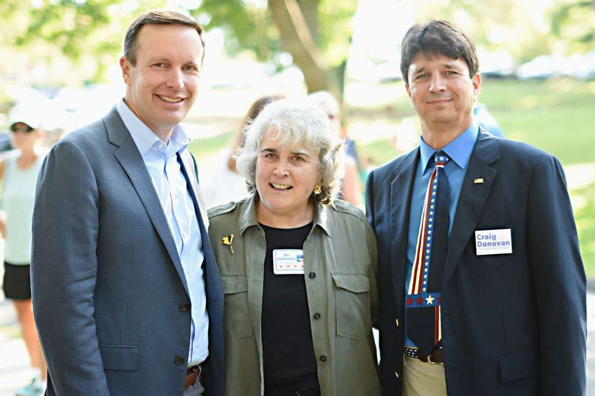 U.S Sen. Chris Murphy, New Canaan Selectman Kit Devereaux and then First Selectman Candidate Craig Donovan stand for a photo at one of the New Canaan Democratic Town Committee's barbecues during a recent year. Devereaux is leaving the town for Annapolis, Maryland, in August to be nearer her daughter Anne, and her grandson William Coldstock.