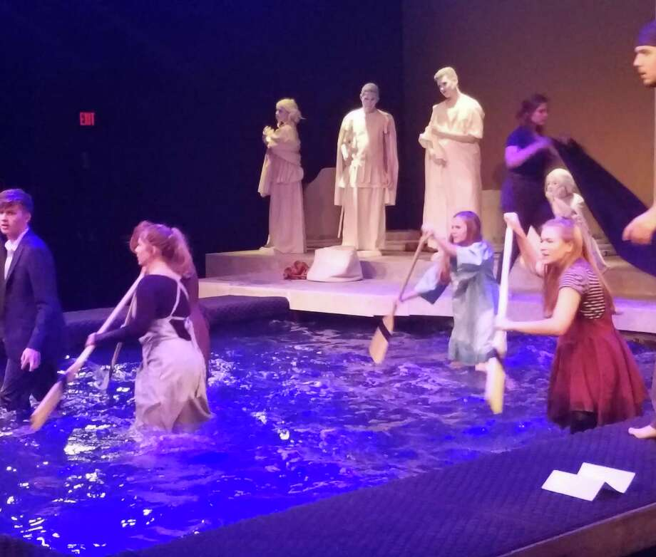 """Katy High School Theater students constructed and acted in a 4,000 gallon pool for their production of """"Metamorphoses"""". Photo: Claire Goodman"""
