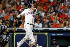 Houston Astros right fielder Josh Reddick (22) singles on a fly ball to centerfield during the seventh inning of Game 5 of the American League Division Series at Minute Maid Park in Houston, on Thursday, Oct. 10, 2019.