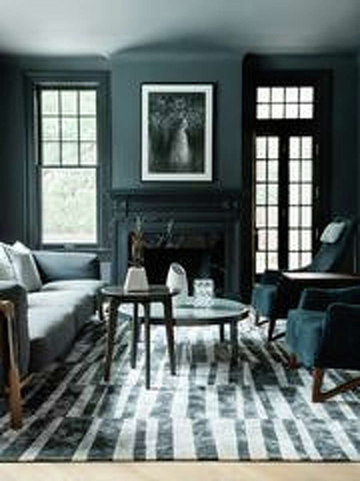 Inside, Sudhoff and Hooker, an architect, went for mostly white and light interiors, but created a moody escape in this front sitting room.