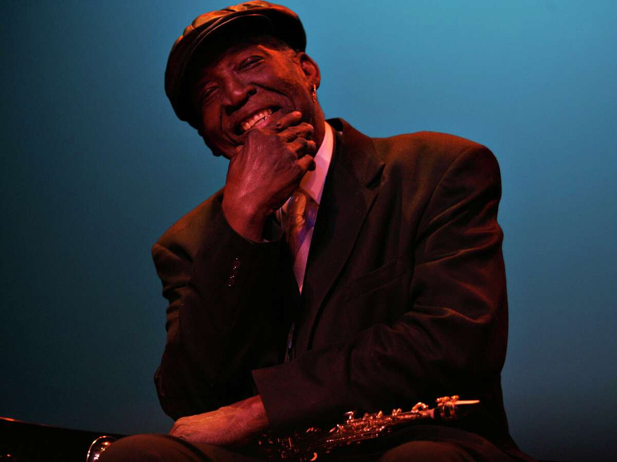 Saxophonist Spot Barnett takes in the applause after playing at the Jamming with Legends performance in 2007 at the Carver Community Cultural Center.