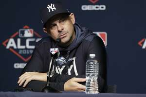 New York Yankees manager Aaron Boone listens to a question during a news conference at Yankee Stadium in New York, Thursday, Oct. 10, 2019. The Yankees will play the winner of tonight's Tampa Bay Rays at Houston Astros American League Division Series game in Game 1 of the American League Championship Series on Saturday, Oct. 12 in New York.(AP Photo/Frank Franklin II)