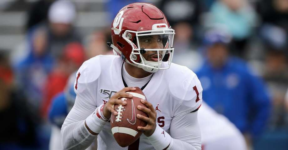 Oklahoma quarterback Jalen Hurts (1) looks for a receiver during the second half of an NCAA college football game against Kansas Saturday, Oct. 5, 2019, in Lawrence, Kan. (AP Photo/Charlie Riedel) Photo: Charlie Riedel/Associated Press