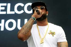 """Rapper Slim Thug performs during the """"Welcome to Houston all-star rap set"""" segment at Day for Night festival Saturday, Dec. 17, 2016, in Houston. ( Yi-Chin Lee / Houston Chronicle )"""