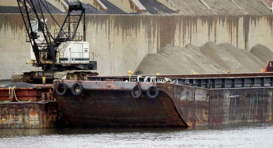 A barge is photograph on Oct. 9, 2019 docked at O&G Stamford Sand and Stone Yard. Photo: Matthew Brown / Hearst Connecticut Media / Stamford Advocate