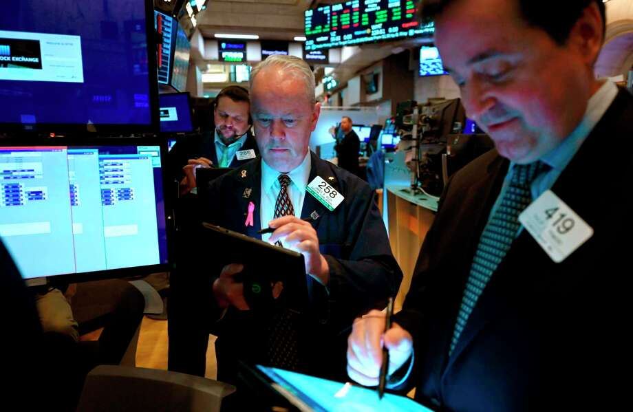 "Traders work during the opening bell at the New York Stock Exchange (NYSE) on October 11, 2019, at Wall Street in New York City. - Wall Street stocks jumped early Friday on optimism for progress in US-China negotiations, including a possible agreement to pause new tariff measures. The talks in Washington, now in their second day, were given a positive push by US President Donald Trump, who said the negotiations were ""going really well"" and was scheduled to meet later Friday with China's top trade envoy Liu He. (Photo by Johannes EISELE / AFP) (Photo by JOHANNES EISELE/AFP via Getty Images) Photo: JOHANNES EISELE / AFP or licensors"