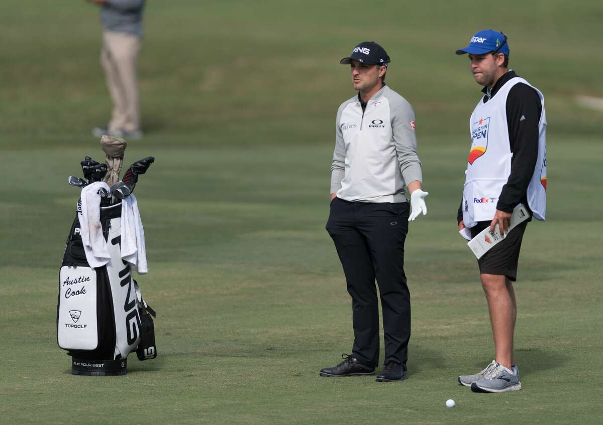 Austin Cook confers with his caddy before hitting the ball on the 13th fairway during the Houston Open at the Golf Club of Houston in Humble Texas on Friday, October 11, 2019.