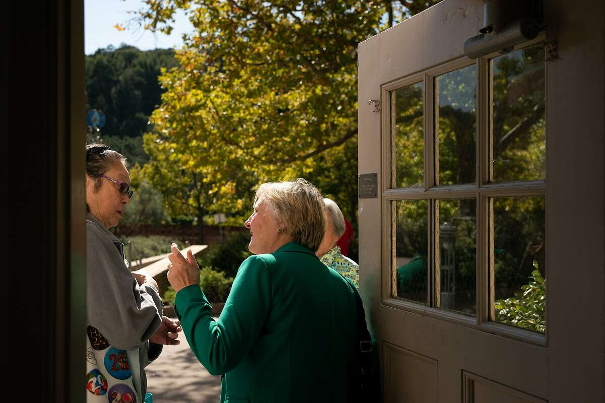 Amy Worth, Orinda City Council member, answers questions about the power outage from May Poon, left, and Joy Chow at the Orinda Community Center on Friday, Oct. 11, 2019 in Orinda, Calif.