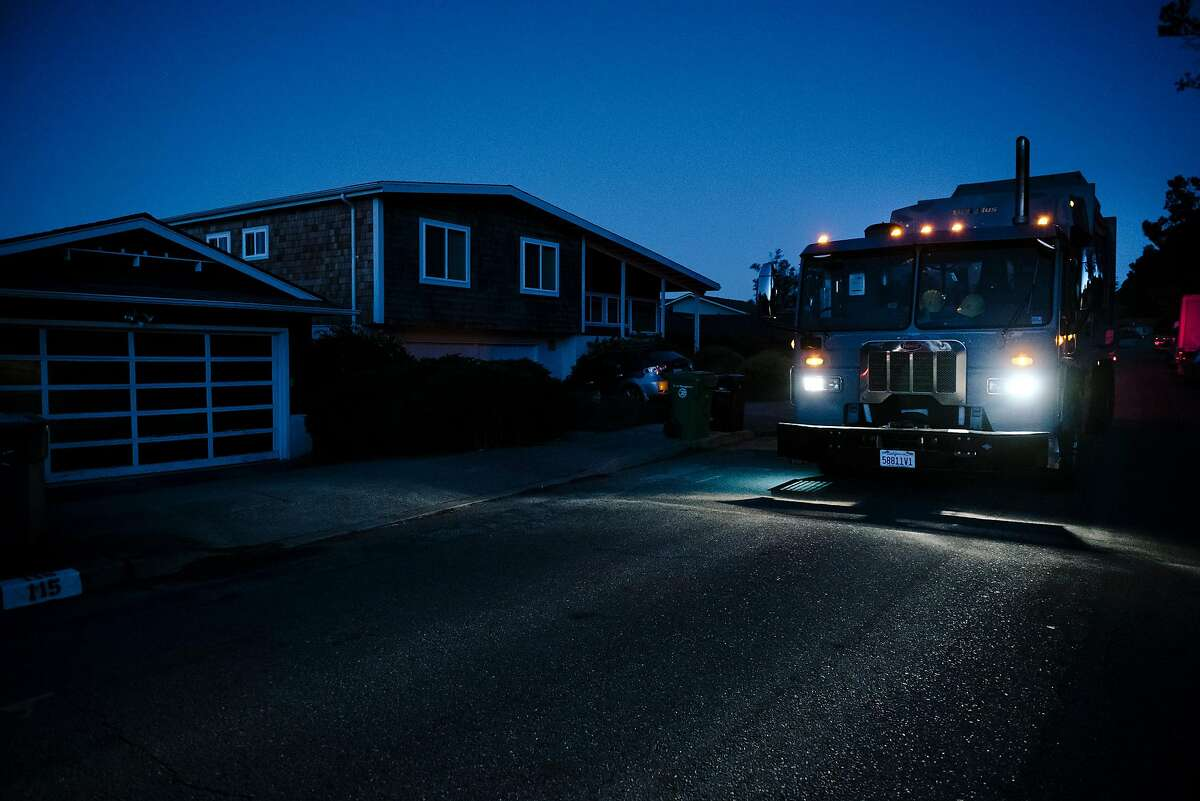 Dennis McMinn of California Waste Solutions said ithat even though he is used to working in the dark of early mornings, it was strange not to have the street lights on as he picks up recycling in a darkened neighborhood off of Skyline Boulevard in Oakland, California, on Friday, Oct. 10, 2019. PG&E planned power outages affected parts of Oakland and Alameda County as the utility fights to stave off wildfires that can be caused by high winds hitting their power lines.