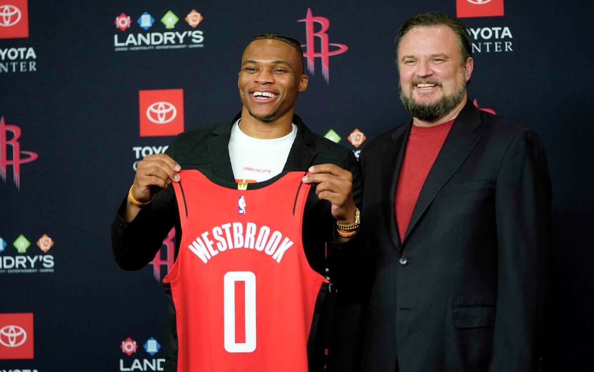 Houston Rockets General Manager Daryl Morey, right, poses with recently acquired guard Russell Westbrook during an NBA basketbll news conference. A backlash followed Morey's tweet supporting Hong Kong protesters.