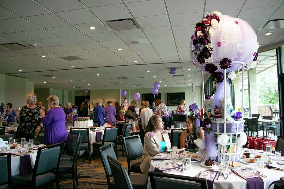 FamilyTime's 8th Annual Purple Ribbon Luncheon filled the Kingwood Country Club banquet hall on Oct. 11 to raise awareness for domestic violence. Photo: Savannah Mehrtens/Staff Photo / Savannah Mehrtens/Staff Photo