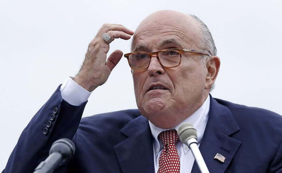 FILE - In this Aug. 1, 2018 file photo, Rudy Giuliani, attorney for President Donald Trump, addresses a gathering during a campaign event in Portsmouth, N.H. House committees have subpoena Giuliani for documents related to Ukraine. (AP Photo/Charles Krupa, File ) Photo: Charles Krupa / Associated Press